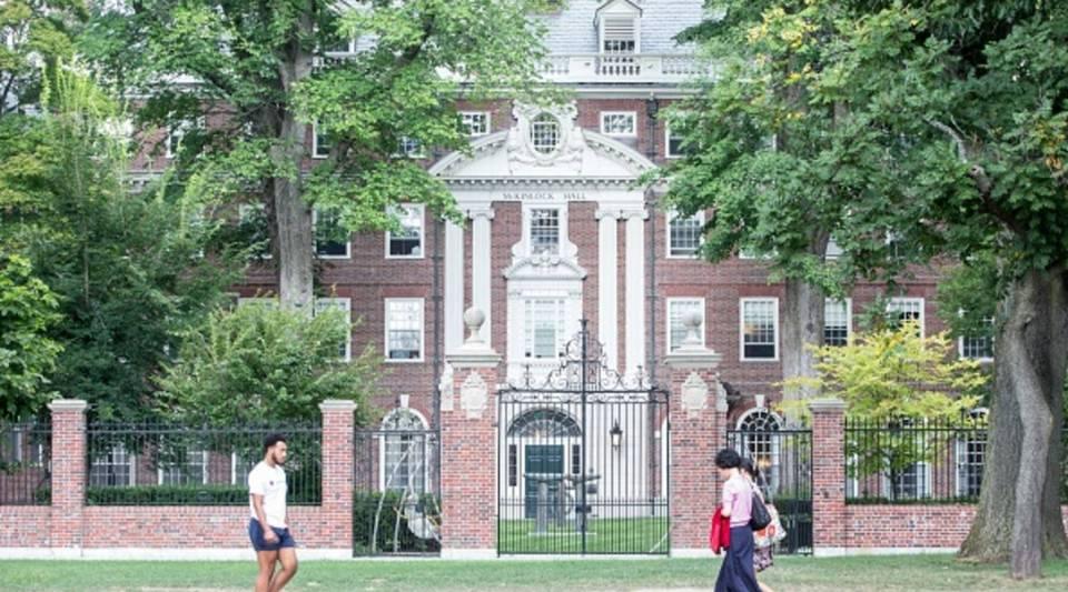 Pedestrians walk past a Harvard University building on Aug. 30, 2018 in Cambridge, Massachusetts.