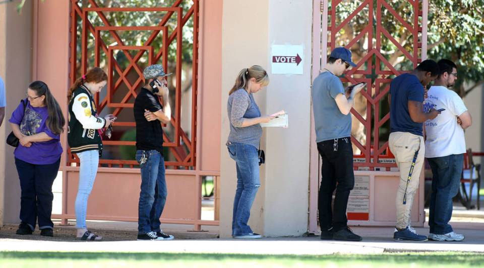 Arizona voters wait in line to cast their ballot at a polling place during the midterm elections on November 6, 2018 in Phoenix, Arizona. Arizonans are deciding on a U.S. Senate seat between Republican Martha McSally and Democrat Kyrsten Sinema, among other local races.