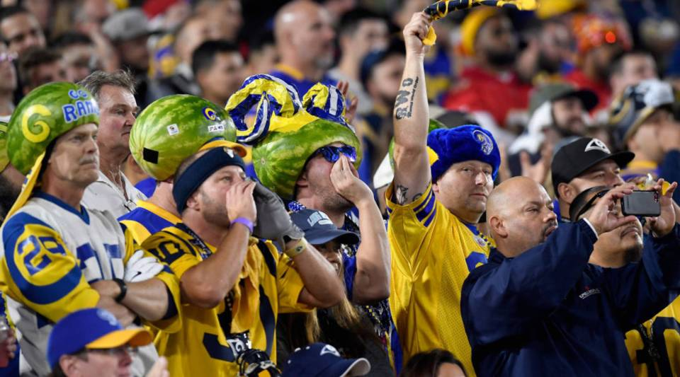 Los Angeles Rams fans cheer on their team during the game against the Kansas City Chiefs at Los Angeles Memorial Coliseum on November 19, 2018 in Los Angeles, California.