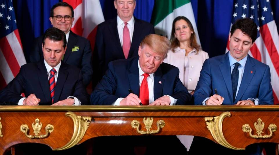 Mexico's President Enrique Pena Nieto (L) US President Donald Trump (C) and Canadian Prime Minister Justin Trudeau, sign a new free trade agreement in Buenos Aires, on November 30, 2018, on the sidelines of the G20 Leaders' Summit. - The revamped accord, called the US-Mexico-Canada Agreement (USMCA), looks a lot like the one it replaces. But enough has been tweaked for Trump to declare victory on behalf of the US workers he claims were cheated by NAFTA.