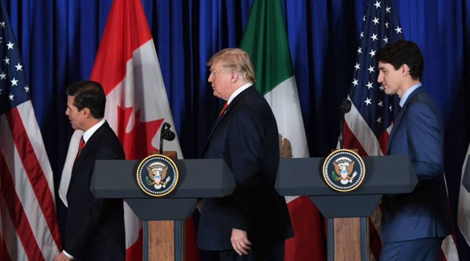 (L to R) Mexican President Enrique Pena Nieto, US President Donald Trump and Canadian Prime Minister Justin Trudeau leave after delivering a statement on the signing of a new free trade agreement in Buenos Aires, on November 30, 2018, on the sidelines of the G20 Leaders' Summit.