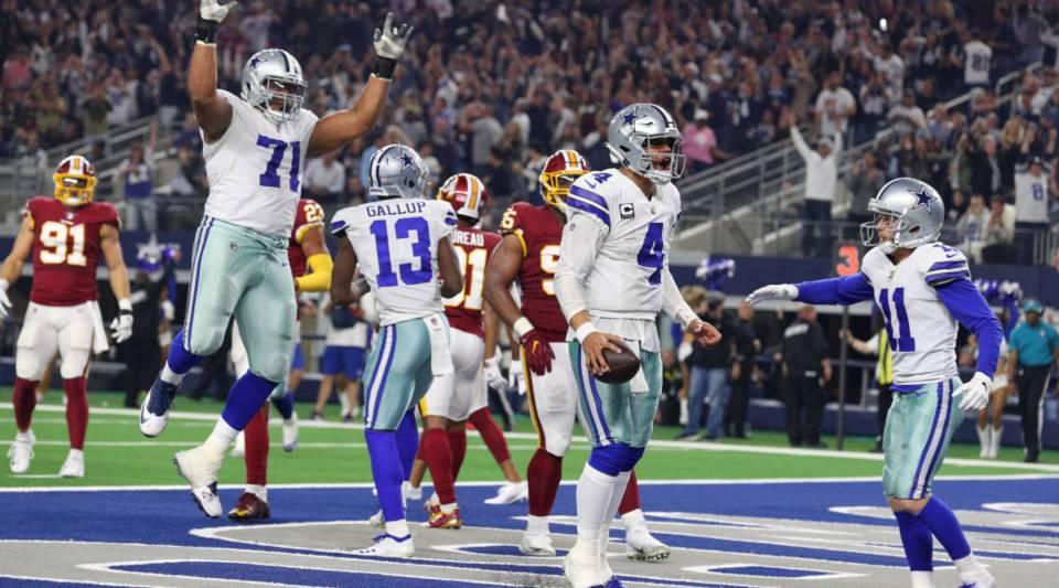 The Dallas Cowboys including La'el Collins #71 and Cole Beasley #11 celebrate the fourth quarter touchdown by Dak Prescott #4 against the Washington Redskins at AT&T Stadium on November 22, 2018 in Arlington, Texas.