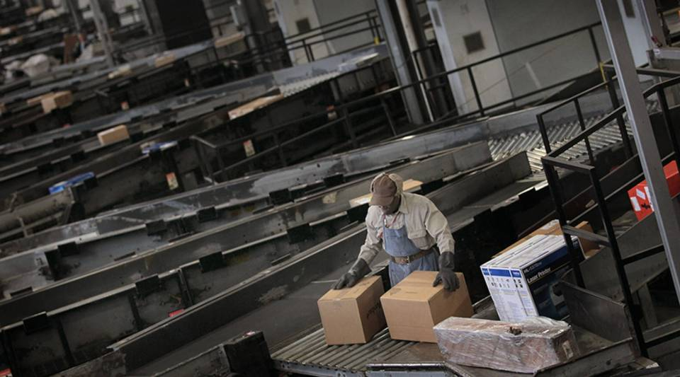 A worker sorts packages at a UPS facility in 2010 in Hodgkins, Illinois.