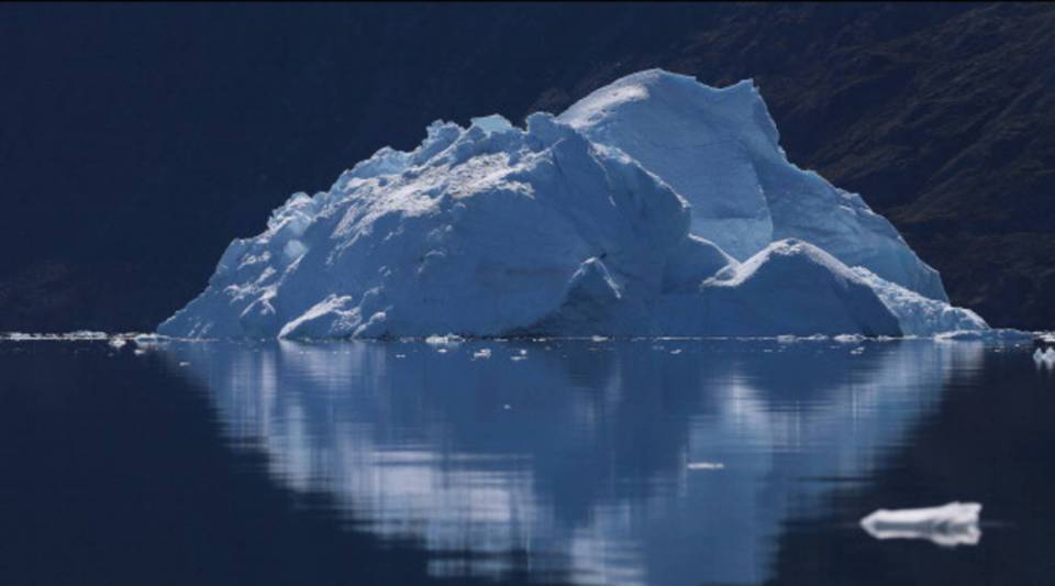 An iceberg floats through the water on July 21, 2013 in Ilulissat, Greenland.