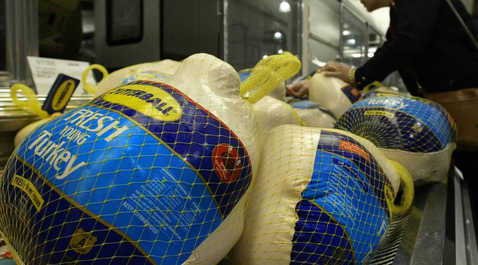 A customer looks over turkeys for sale at Costco, 2004.