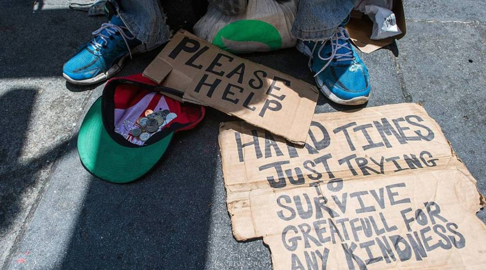 Andrew Loy begs along a sidewalk in downtown San Francisco, California on Tuesday, June, 28, 2016. Homelessness is on the rise in the city irking residents and bringing the problem under a spotlight.