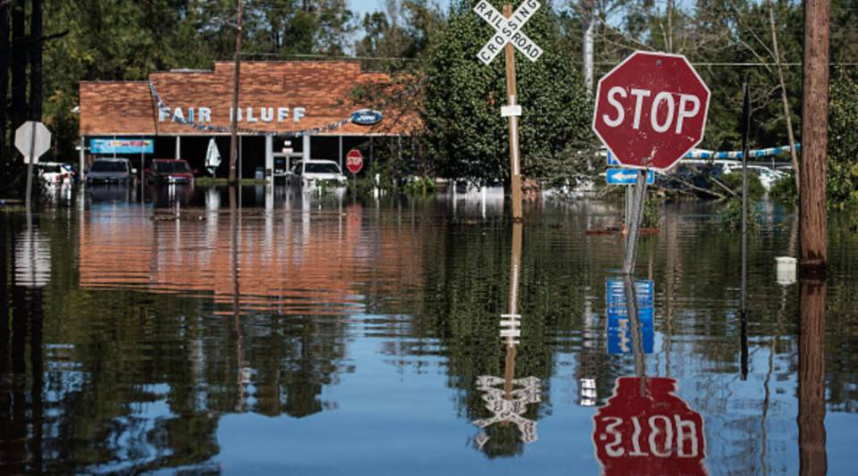A roadway is flooded by remnants of Hurricane Matthew on Oct. 11, 2016 in Fair Bluff, North Carolina. The town was devastated again by Hurricane Florence in 2018.