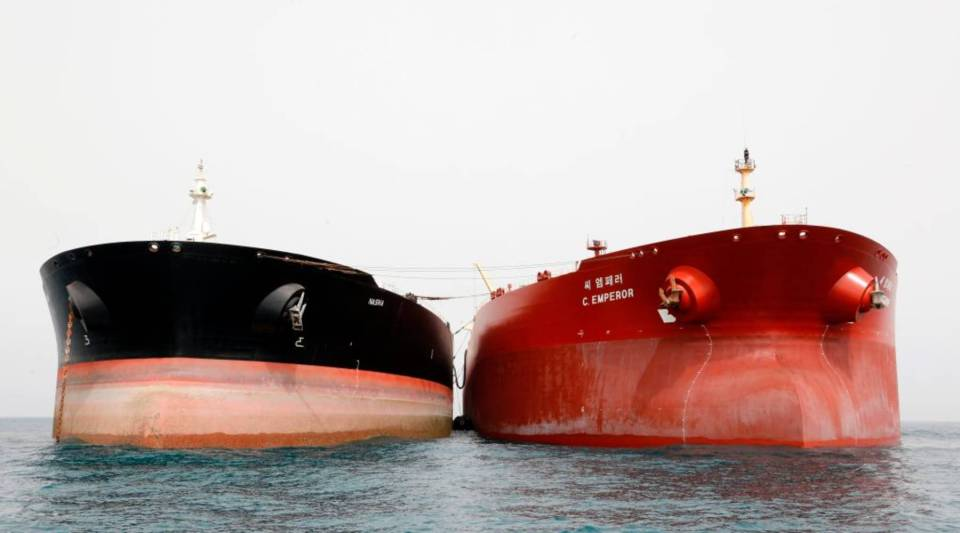 A picture taken on March 12, 2017, shows an Iranian tanker and a South Korean (R) tanker docking at the platform of the oil facility in the Khark Island, on the shore of the Gulf.
