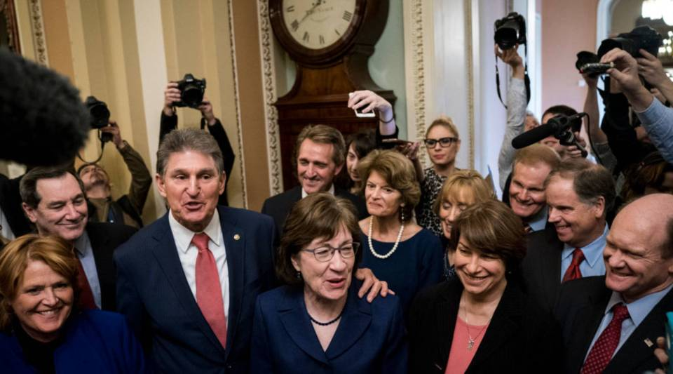 Senators Joe Manchin and Susan Collins lead a group of bipartisan Senators as they speak to reporters after the Senate passed a procedural vote for a continuing resolution to fund the federal government, Capitol Hill, January 22, 2018 in Washington, DC.
