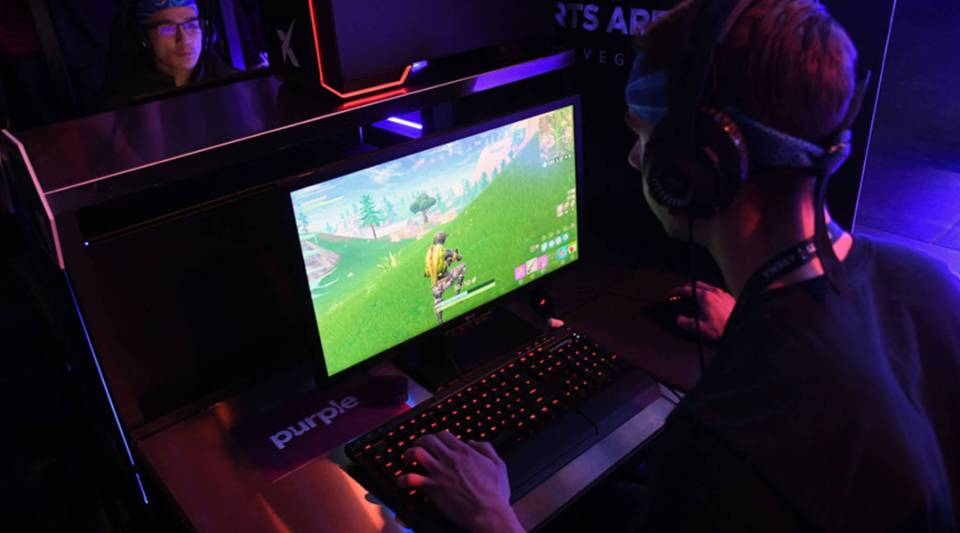 "Gamers play ""Fortnite"" against Twitch streamer and professional gamer Tyler Blevins during Ninja Vegas 18 at the Luxor Hotel & Casino in April."
