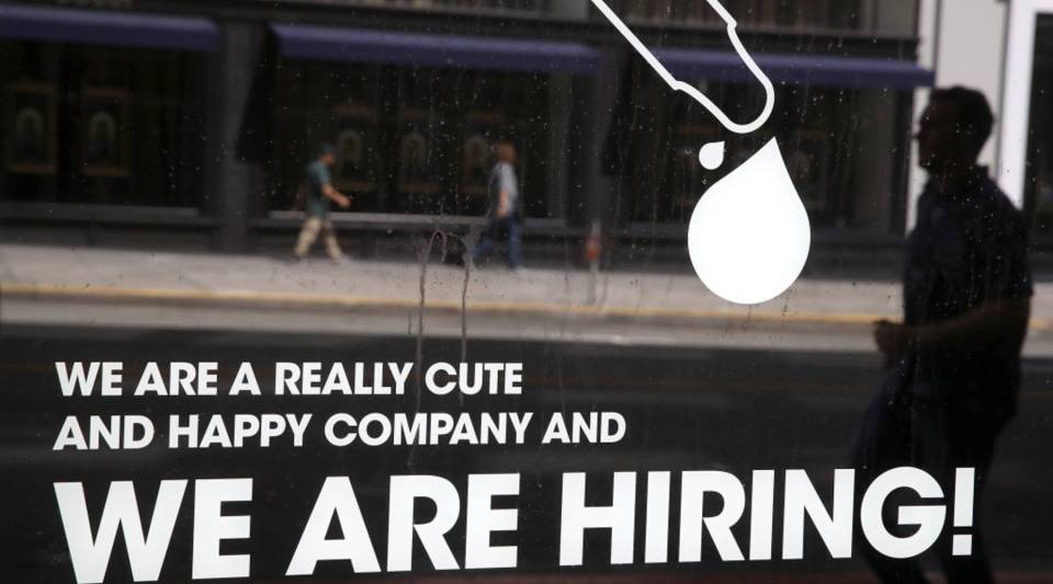 A now hiring sign is posted on the window of a business on June 1, 2018 in San Francisco, California.