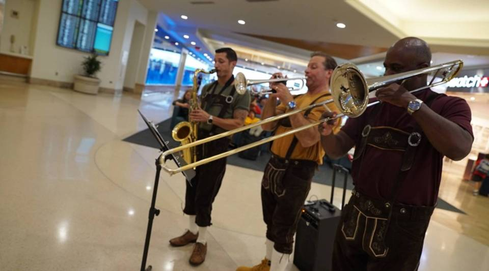 A band entertains travelers at the Orlando International Airport.