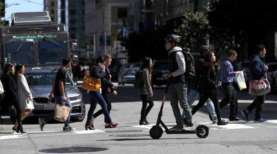 A user rides a Spin scooter in San Francisco.