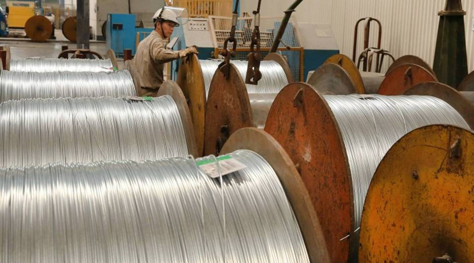 A worker handles steel cables at a factory in Nantong in China's eastern Jiangsu province in July.