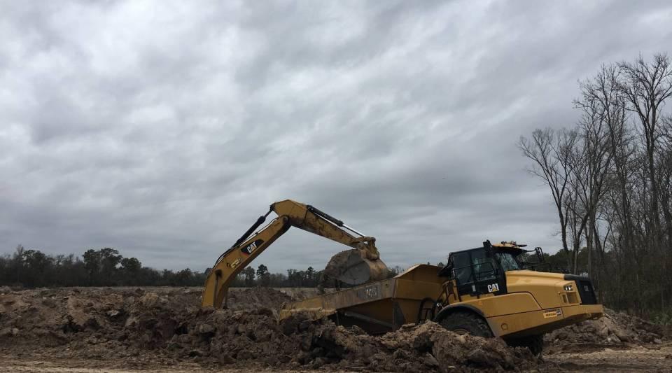 Excavators dig massive pits at the River Aggregates sand mine near Houston, Texas.