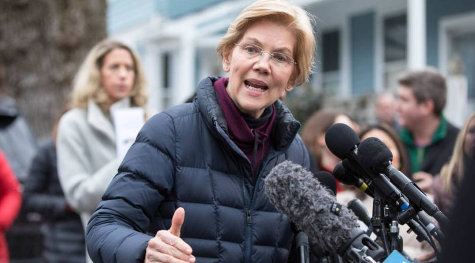 Sen. Elizabeth Warren (D-MA) addresses the media outside of her home in Cambridge, Massachusetts, after announcing she formed an exploratory committee for a 2020 presidential run on Monday.