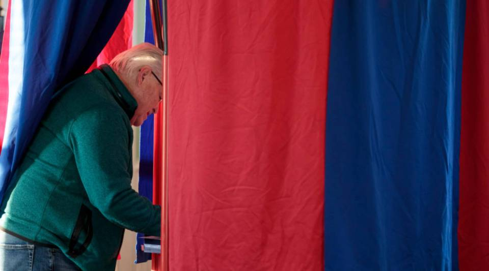 A man casts his midterm ballot on Nov. 6, 2018 at Briles Schoolhouse in Peoria Township, Kansas.