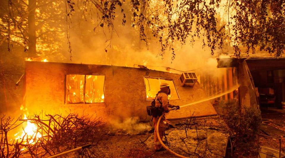 Firefighters battle flames at a burning apartment complex in Paradise, north of Sacramento, California, on Nov. 09.