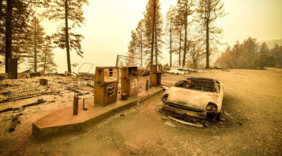 A burned car and a gas station remain visible after the Camp Fire tore through the region near Pulga, east of Paradise, California, on Nov. 11, 2018.