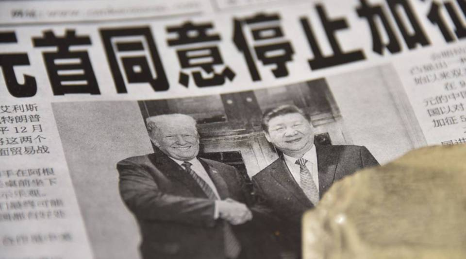 At a news stand in Beijing, a newspaper features a story about the meeting between U.S. President Donald Trump and Chinese President Xi Jinping.