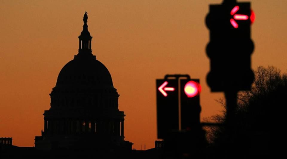 The sun begins to rise over Washington as the federal government is in a partial shutdown, on Dec. 23, 2018 in Washington, DC.
