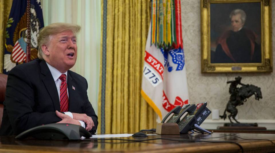 U.S. President Donald Trump makes a video call to service members from the Army, Marine Corps, Navy, Air Force, and Coast Guard stationed worldwide in the Oval Office at the White House Dec. 25, 2018 in Washington, DC.