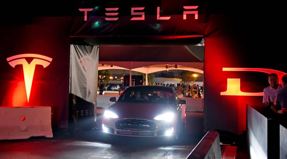 Tesla owners take a ride in the Tesla D model electric sedan in 2014 in Hawthorne, California.