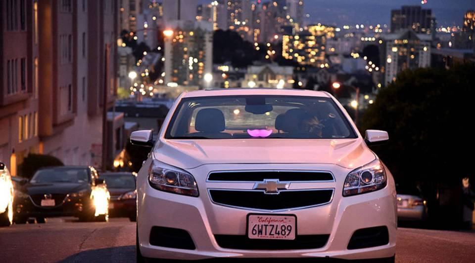 A Lyft driver is waiting for a ride in the city on Feb. 3, 2016 in San Francisco, California.