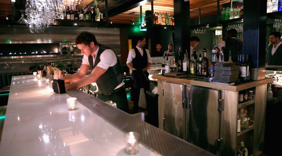 Popular restaurant design elements like hard, minimal surfaces, open kitchens and attached bars are responsible for restaurants' climbing decibel levels.