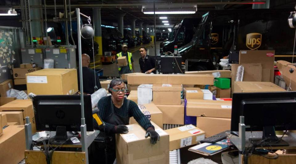 """UPS employees sort out packages for delivery on May 9, 2017 in New York. This holiday season, """"super hubs,"""" like the one in Atlanta, will help the company deliver 800 million packages on time. Last year, 3 million were late."""