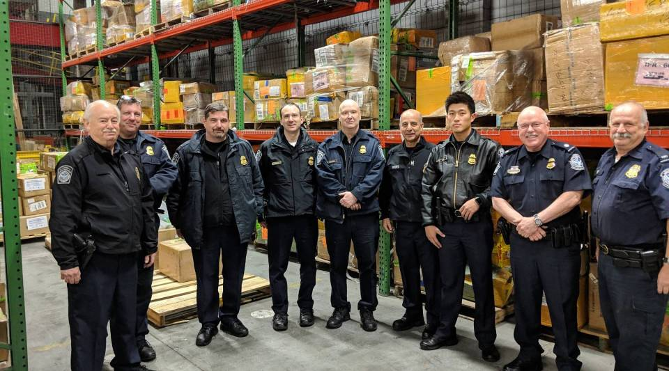 Customs officers in the DHL warehouse at JFK Airport.