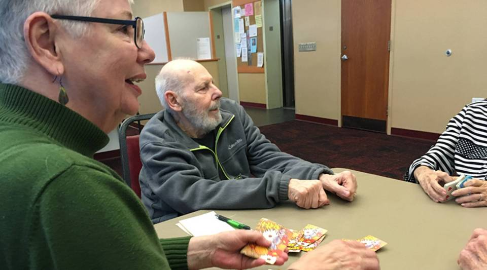 Kathy Stevens, 67, plays bridge with friends at Riverview Towers in Pittsburgh. Stevens lost about a third of her savings during the financial crisis in 2008. It set off a decade of scaling back and she now lives in subsidized senior housing.