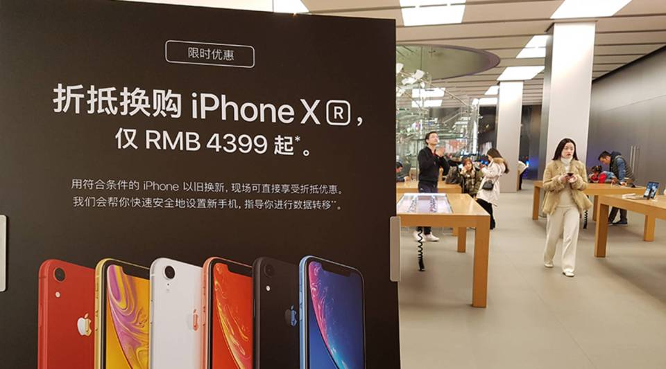 An Apple store in Shanghai offers customers a discount on the new iPhone XR model if they trade in an older iPhone model.