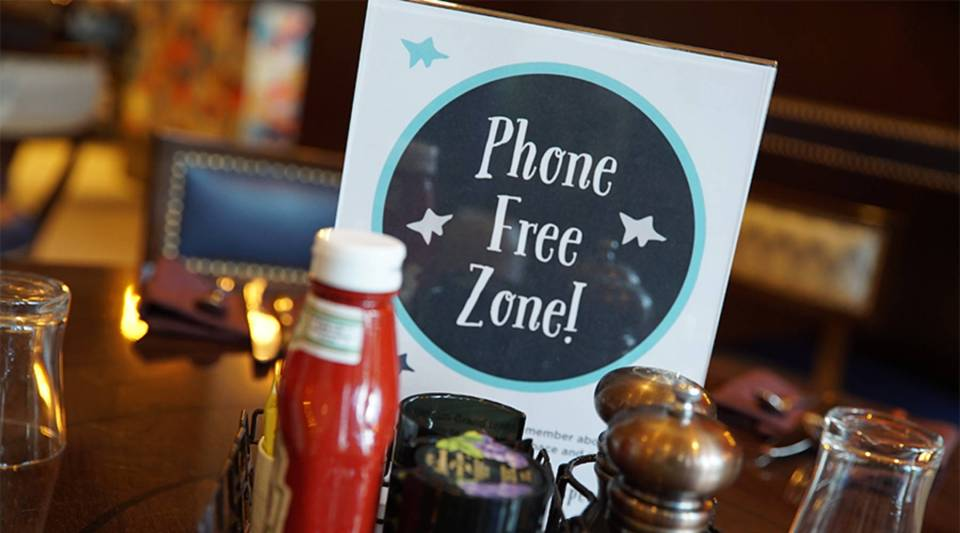 Cell phones are competition for an industry whose product is creating experiences for people to enjoy in the here and now, says Art Markman, University of Texas at Austin psychologist.