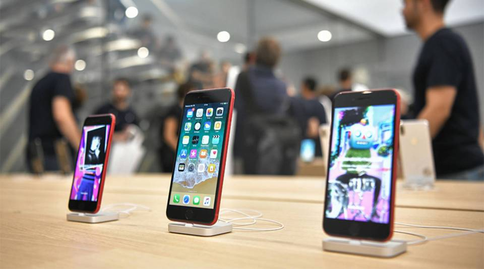 iPhones at an Apple store in Milan.