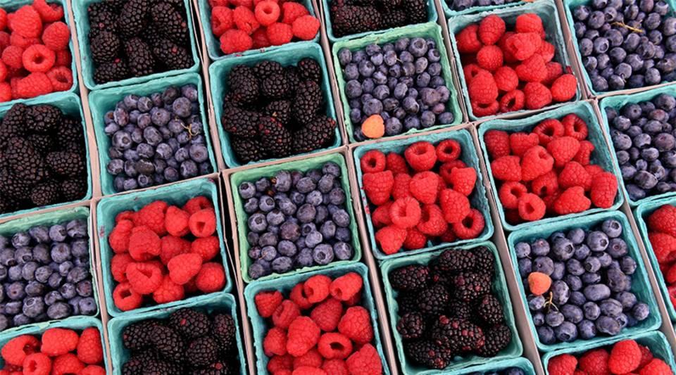 California Blueberries, Raspberries and Blackberries on sale at a market in Los Angeles, California.