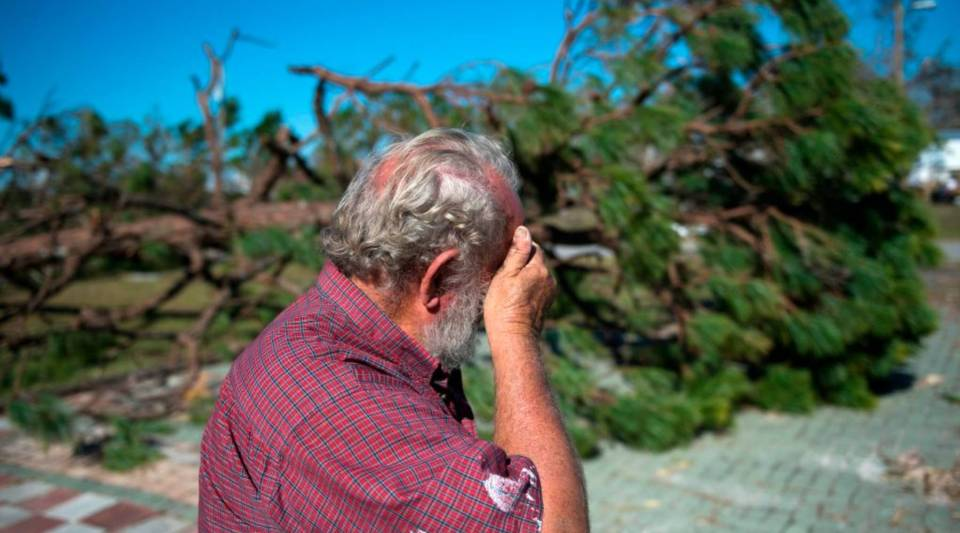 Donnie Young reacts after seeing one of his houses in Port St. Joe beach, Florida, on October 13, 2018, three days after Hurricane Michael hit the area.