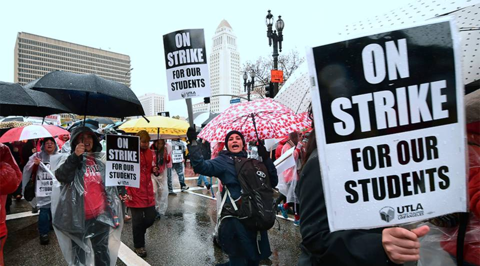 Thousands of teachers march in the rain through Los Angeles on Monday, on the first day of the first teachers strike in 30 years targeting the Los Angeles Unified School District.