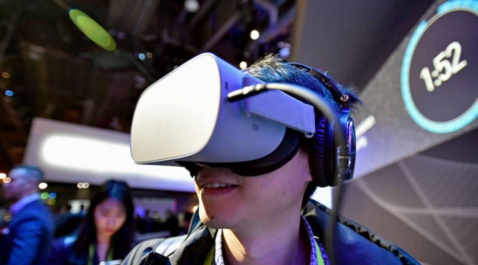 An attendee uses a virtual reality headset to experience automotive safety at the Panasonic booth at CES 2019 at the Las Vegas Convention Center on January 8, 2019 in Las Vegas, Nevada.