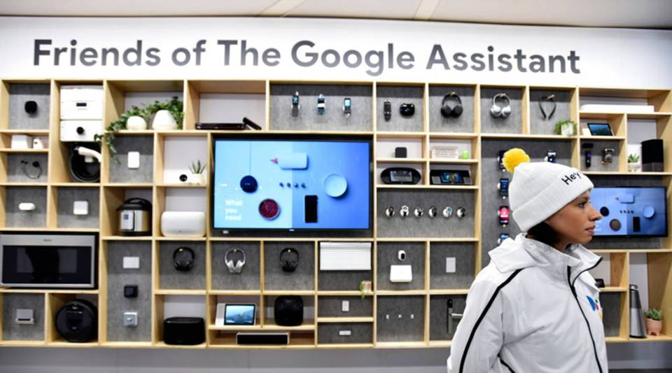 A Google representative watches over a display of Google Assistant products at the at CES 2019 at the Las Vegas Convention Center on Jan. 8.