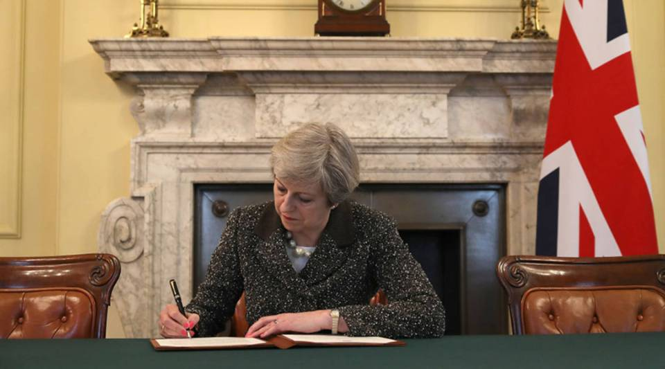 British Prime Minister Theresa May in 2017 signs the official letter to the European Council invoking Article 50 and the United Kingdom's intention to leave the EU.