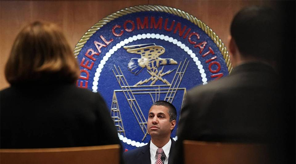 Federal Communications Commission Chairman Ajit Pai listens during a commission meeting December 14, 2017 in Washington, DC.