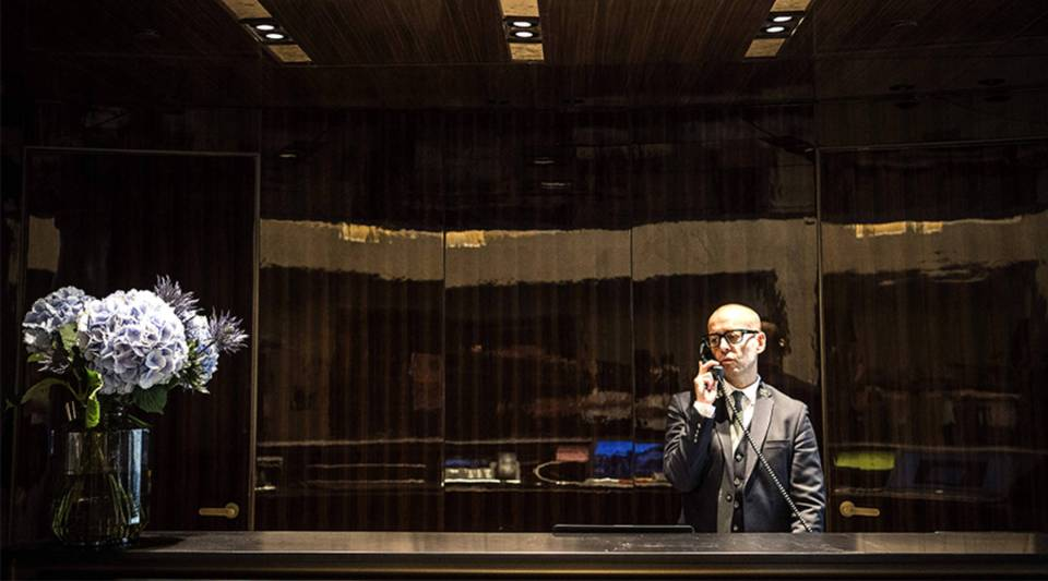 A concierge takes a call at Lutetia Hotel in Paris.