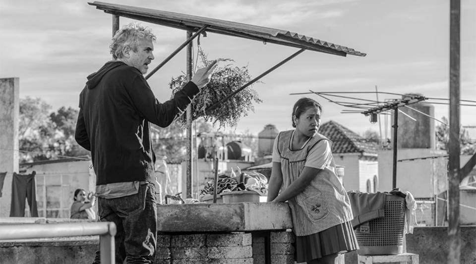 """Alfonso Cuarón and Yalitza Aparicio as Cleo on the set of """"Roma"""" written and directed by Alfonso Cuarón."""