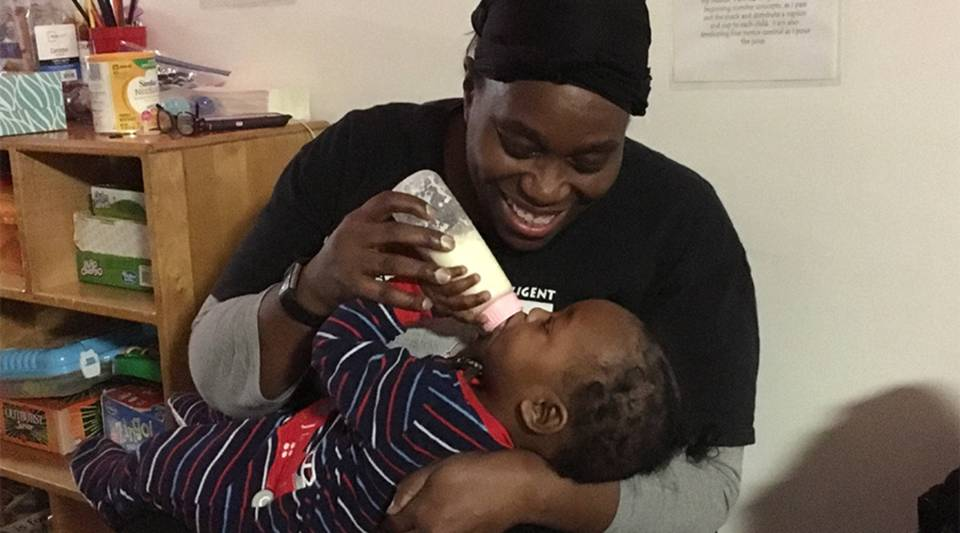 Lesely Crawford, owner of ABK Learning and Development Center in Pittsburgh, gives a baby a midnight feeding at her 24/7 child care.