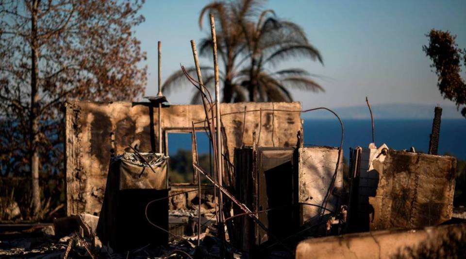 The ruins of an ocean view home are seen in the aftermath of the Woolsey Fire in Malibu, California.