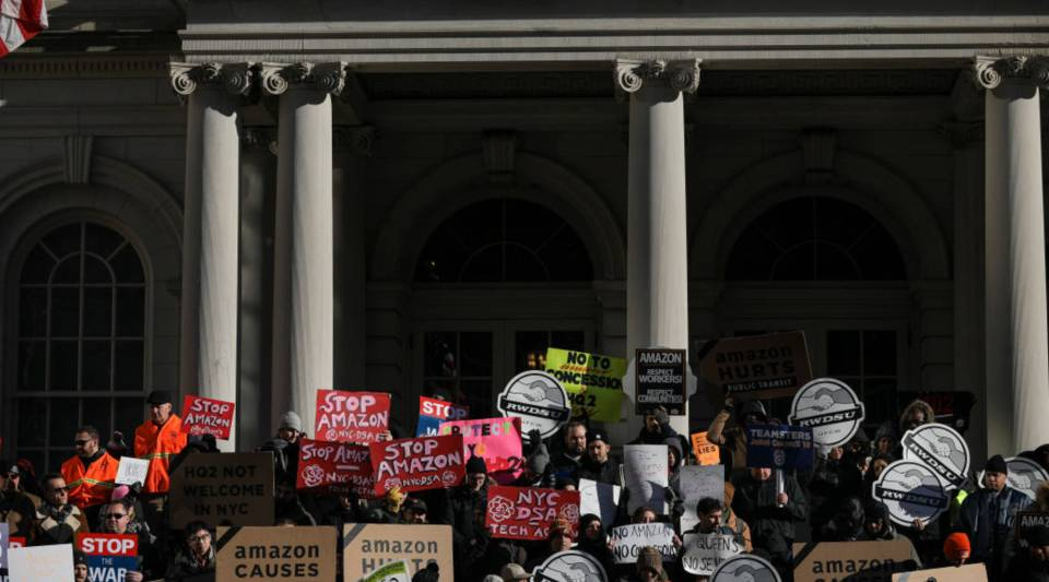 Protesters rally against Amazon's plans to move their second headquarters to the Long Island City neighborhood of Queens, at New York City Hall, Jan. 30, 2019.