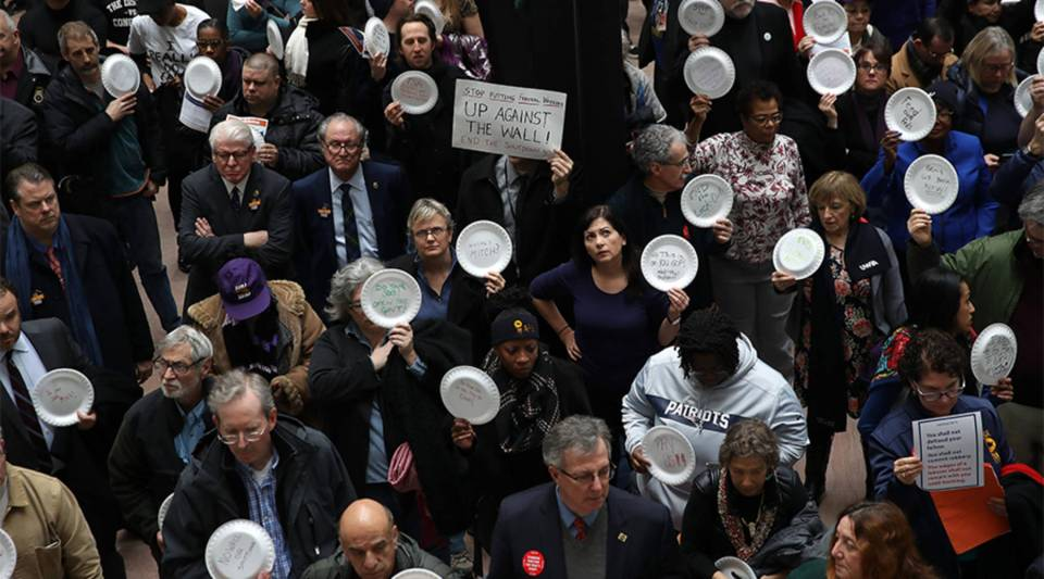 Furloughed federal workers and those aligned with them protest the partial government shutdown in the Hart Senate Office Building Jan. 23, 2019 in Washington, DC.