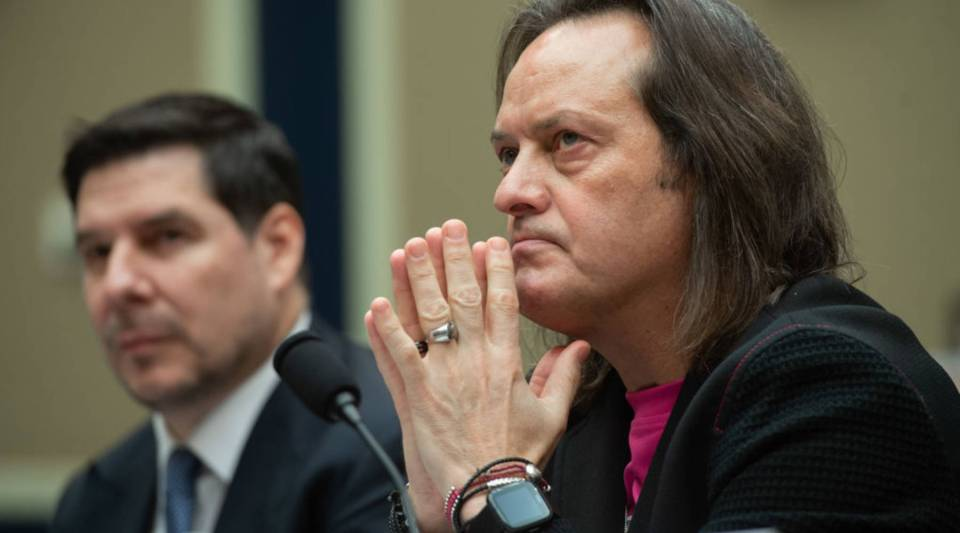 John Legere (R), CEO and President of T-Mobile US, and Marcelo Claure, Executive Chairman of Sprint, testify about the T-Mobile and Sprint merger during a House Energy and Commerce Subcommittee on Communications and Technology hearing on Capitol Hill in Washington, DC, February 13, 2019.
