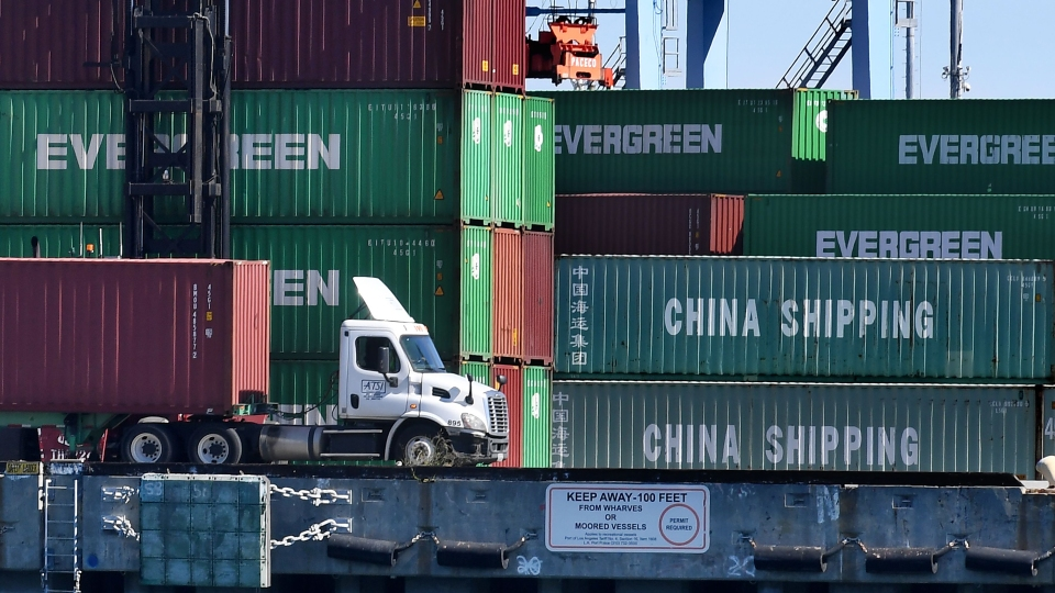 Shipping containers from China and other nations are unloaded at the Long Beach Port in Los Angeles, California on February 16, 2019.